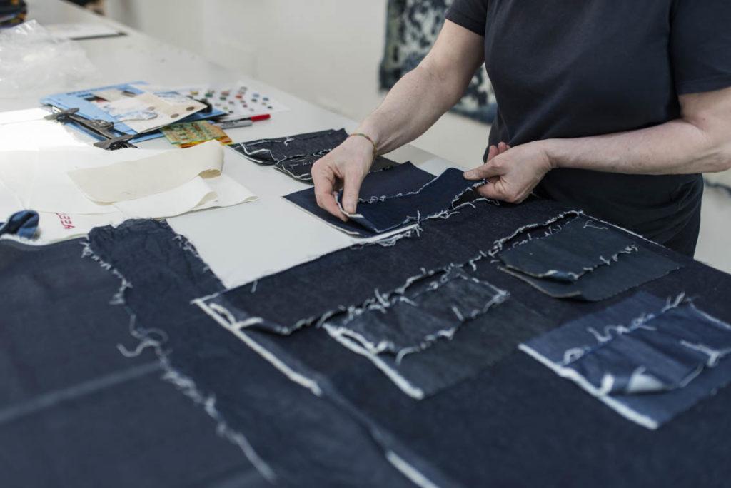 Lucia checks the CALIK DENIM and ROYO textiles shrinkage.